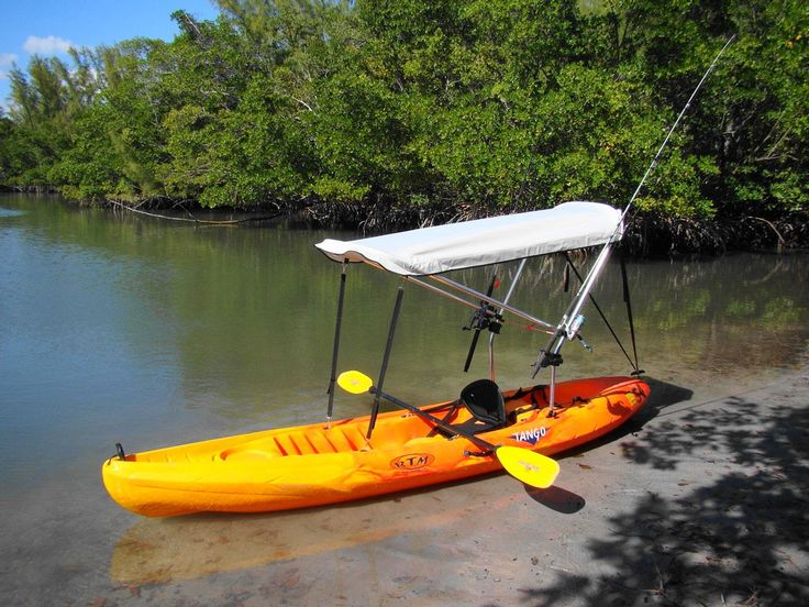 Bimini top for sit on top kayak with fishing rod holders attached to sun shade support poles.