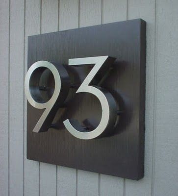 Stainless steel on dark backing                                                                                                                                                                          (Diy House Numbers)
