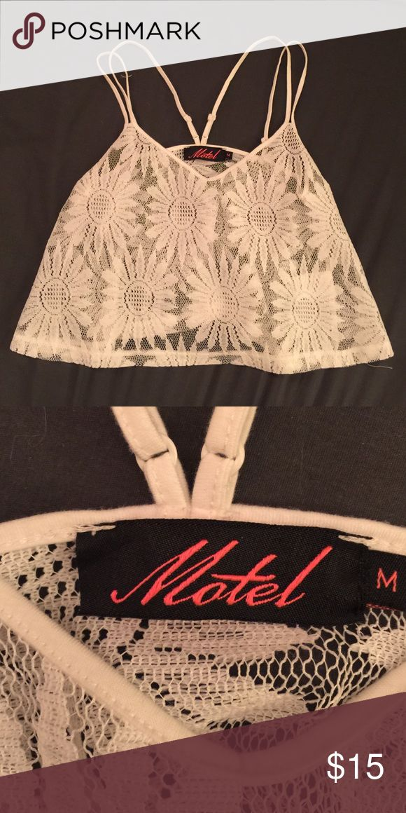 White Flower Cami brand • motel rocks size • medium (could fit small also) wear • no signs of wear  make me an offer on any of my items! 🗣 prices are negotiable. 🤝 treat yo self! 😘  thank you for taking a look in my closet! 💘 Urban Outfitters Tops Crop Tops