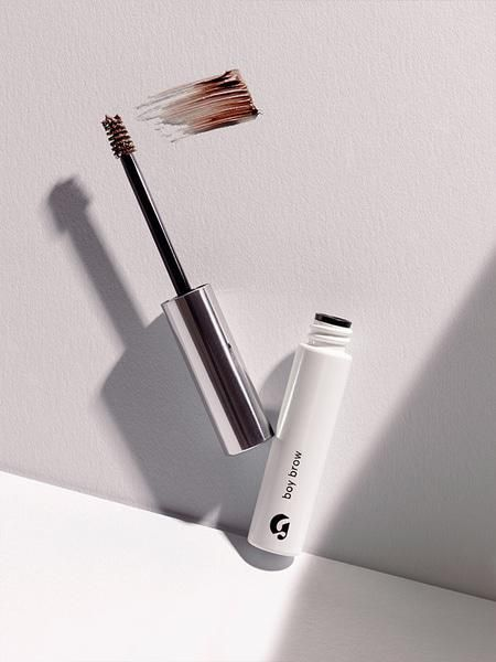 I'd heard so much about boy brow and decided to get it on a whim. it's SO much better than benefit's gimme brow. boy brow picks up the perfect amount of product for your brows and the formula doesn't dry out like gimme brow.  Boy Brow | Glossier