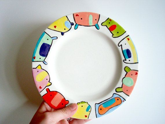 Hand painted ceramic PLATE with kid friendly bright playful color Knitimal monster illustrations in the round by might. $30.00, via Etsy.