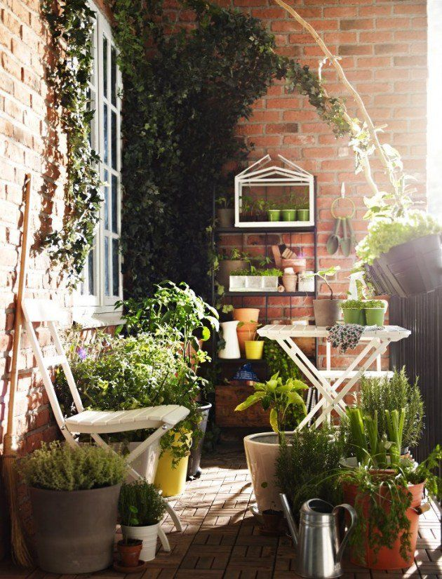 25 Charming Balcony Gardens, I really like the high table (ironing board?) for planting and clipping herbs in pots.