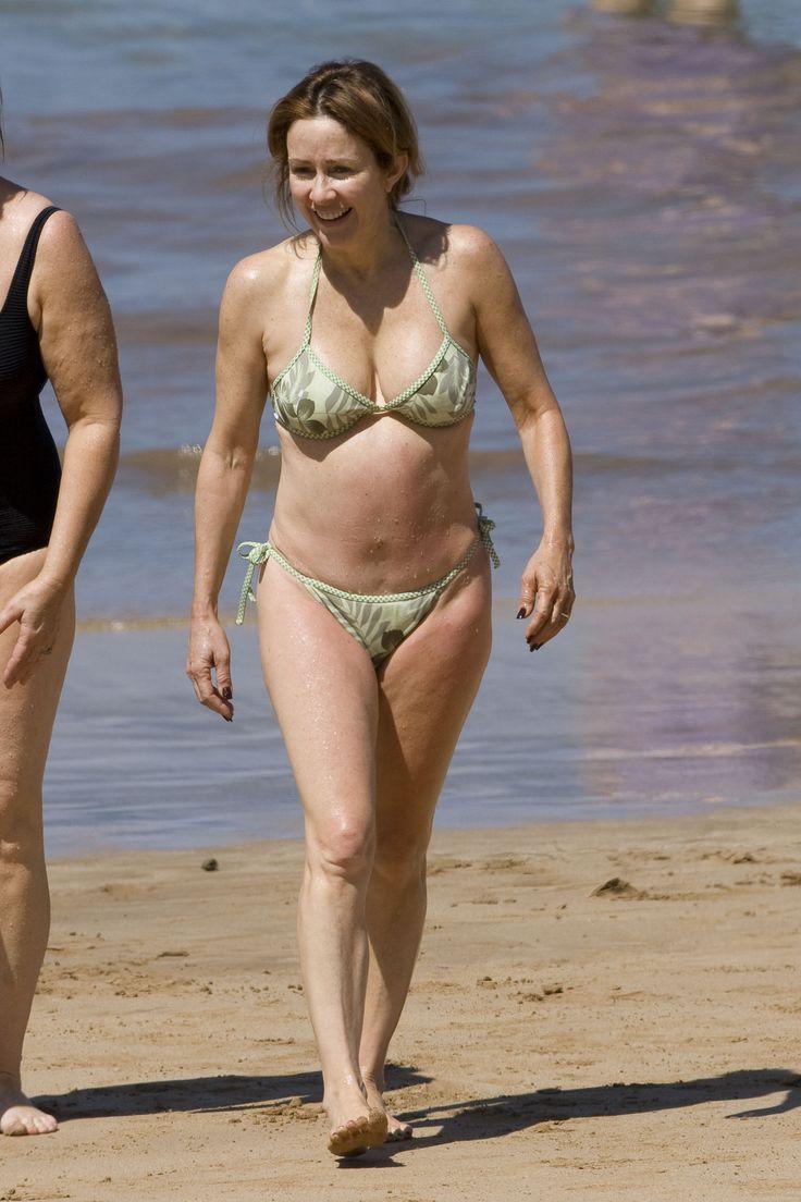 Nude woman looking thru mirror