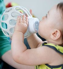 Ba bottle holder      The Original Baby Ba    Baby can get a good grip with these bottle holders! Designed so that very small hands can grab hold of a bottle, the Ba not only looks cool, it's a big help when baby wants to be more independent. $15, TheOriginalBaby.com