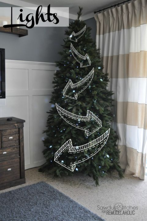 Save yourself the hassle of looping your lights around your entire tree (especially if it's backed into a corner) and just focus on the front. This zig zag shape will make it look like you made it the entire way around.
