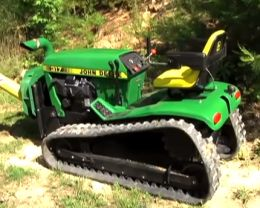 John Deere Crawler - Homemade John Deere lawn tractor crawler made by replacing the wheels on a John Deere 17 with continuous tracks. Also includes custom-built chipper attachment.