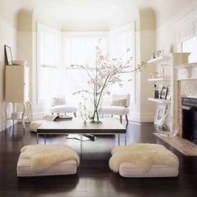love these floor pillows and fur throws, looks like a great conversation room