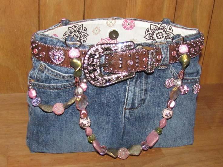 Blue jean purse with flexible sturdy sides and a supportive bottom.