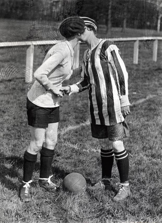 1920, A Kiss Before the Game. Women's Football game between England and France (result 2-0).  The English captain in the striped shirt.