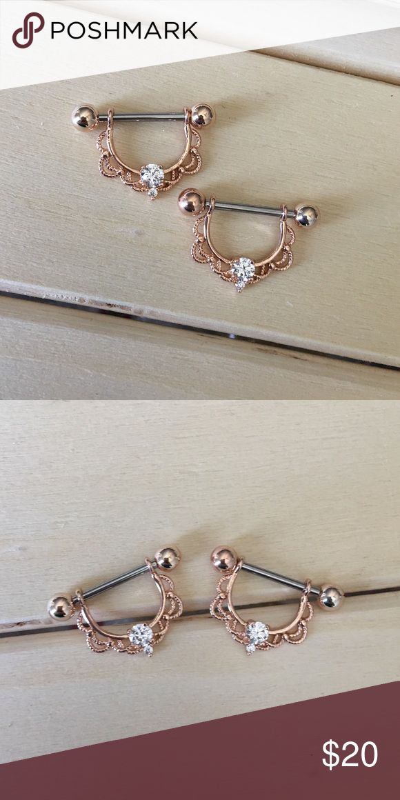 Rose Gold Lace Nipple Rings Brand New! 14 Gauge Surgical Steel. Includes both. Ships within 1-3 days Absolutely no trades. Check out my all my items!  Thanks for looking ☺️ If you have any questions leave a comment below.  Nipple Ring Shield Nipples Piercing 14G Surgical Steel Body Jewelry New Jewelry Rings