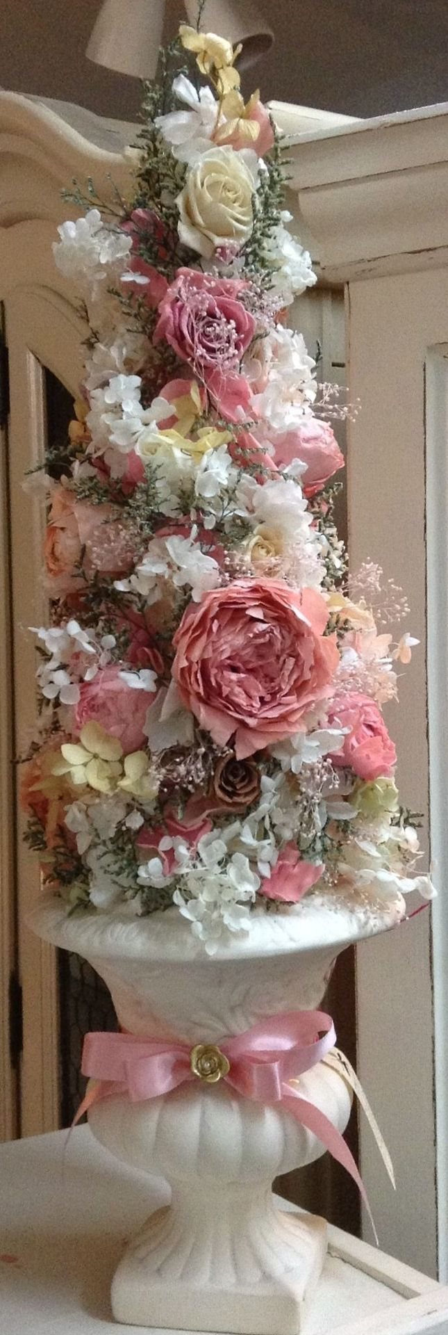 Romantic Cottage-- LARGE cone styrofoam in white pot. glue silk roses and filler flowers to match decor. would use just pink and cream/ivory roses, keep simple