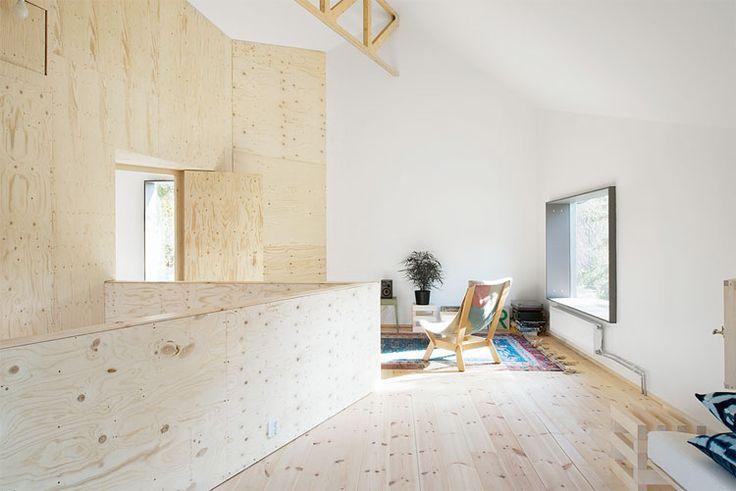 Bijzonder lijnenspel van houten muren en plafonds | Woonguide.nl