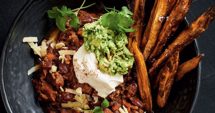 A little spice and a whole lot of comfort, this chilli con carne recipe is one for the ages. Topped with sour cream and guacamole, you can use the sweet potato dippers to dig in.