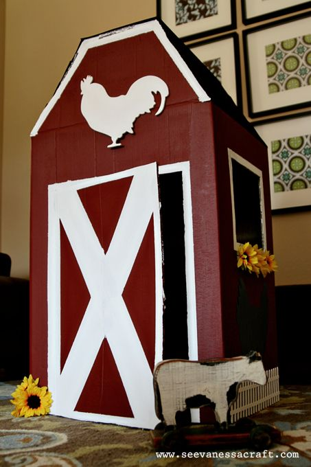 DIY Cardboard Box Barn  This is taking the empty box 'fort' to a whole new level! The rooster  sillouette and window box flowers just add so much charm!