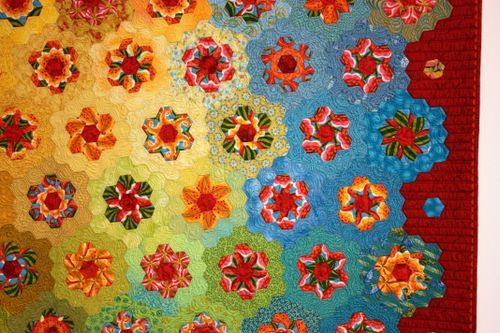 staggering color and fabric selection, fussy cutting, hexagonal piecing, and utterly amazing quilting--quite a package!