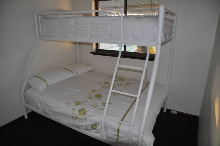 I have one left of two of these double beds with single bunk bed for sale. This includes all matresses and linens as shown in the photo. The top bunk can be removed and installed at any point so you can just use as a double bed until top bunk is required.