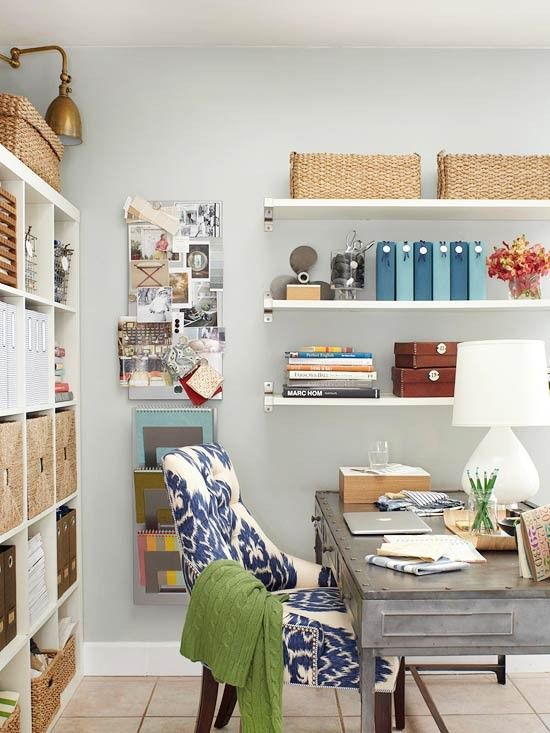 This is such a great home office space the vast expanse of storage space is inspiring and the juxtaposition of the cushy upholstered chair and the