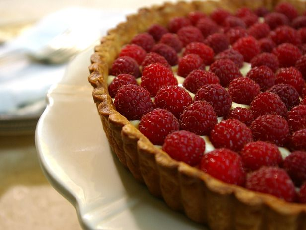 Raspberry Tart. The addition of framboise to this tart's creamy filling gives it an extra dose of raspberry flavor. Topped with the bright, ripe berries, it's almost too beautiful to eat.