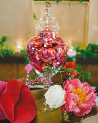 Smooch-Themed Bridal Shower: An apothecary jar housed foil-wrapped chocolate lips.