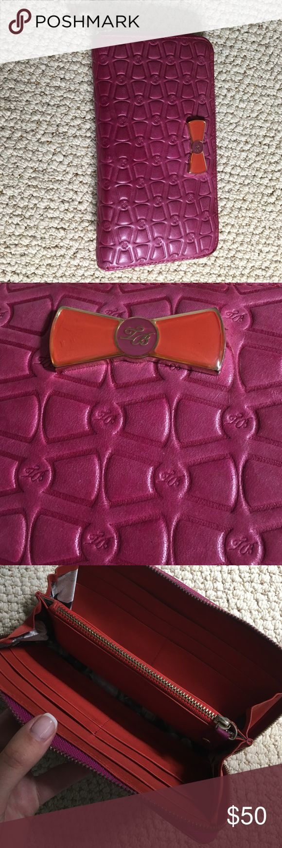 Ted baker wallet Magenta and orange bow Ted Baker wallet with extremely soft leather. Great condition! Ted Baker Bags Wallets