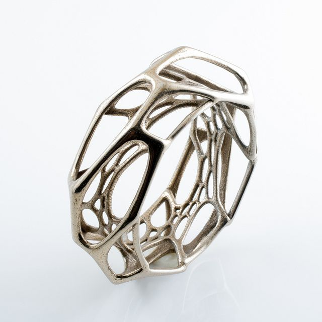 Exo Bangle by Nervous System    3D printed stainless steel bracelet created with the Cell Cycle App
