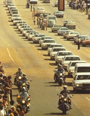 Elvis Presley's Funeral Procession, Memphis 1977 - Police motorcade leading 49 white limousines and the streets are fully lined with people. I remember watching this.