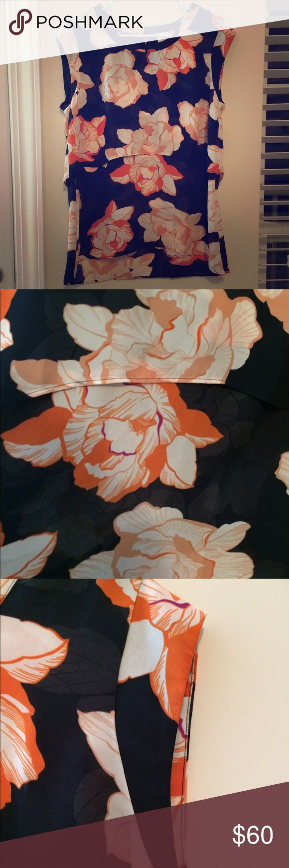 """EUC Cabi blossom top Spring 2015 style #5030 blossom top size medium. EUC No rips, stains or holes. Sad this doesn't fit anymore because this is one of my favorite tops. Adorable tiered layers and slight cap sleeve and no gapping under armpits so your bra is covered. The best color combo of navy, orange, white and accents of magenta. Armpit to armpit 20"""" armpit to hem 18"""" works great with pants, shorts or skirts--super versatile. Meant to be loose but size up or down depending on how you…"""