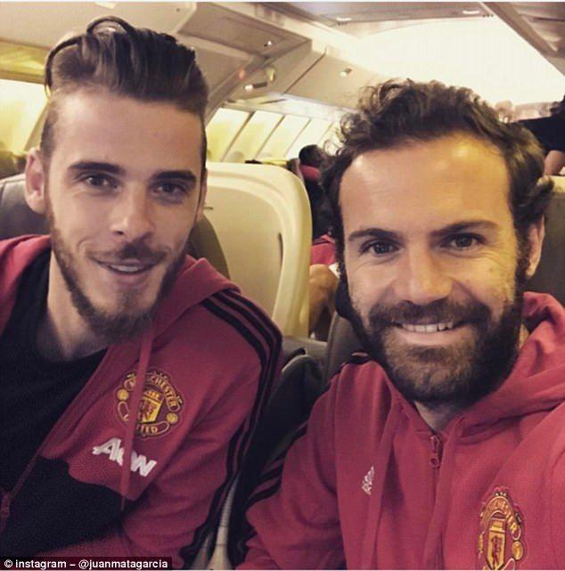 Juan Mata and David De Gea smile for the camera on board Manchester United's flight