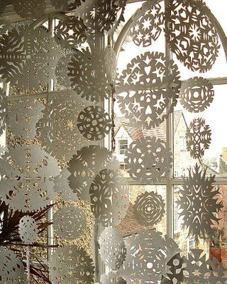 Paper snowflakes curtain. Great winter window display.