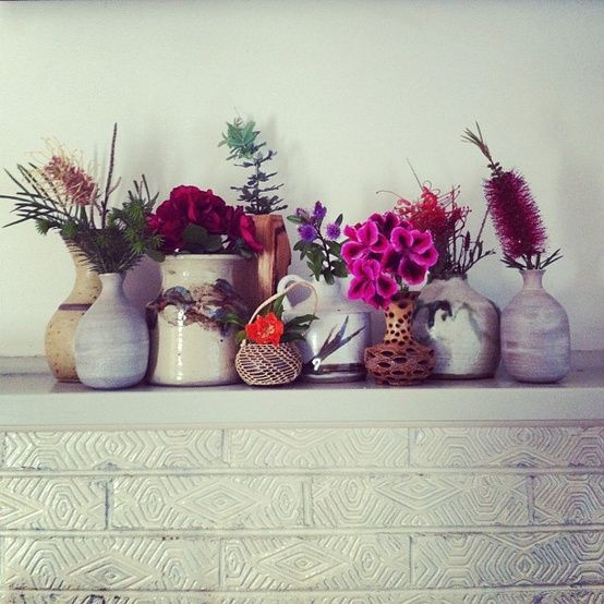 wild flowers in thick ceramic vessels. love the eclectic array