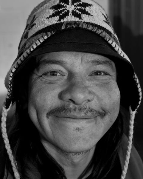"""This is Selvin. He is a musician, has an outrageous laugh and makes you feel right at home with his friendliness. He is also homeless. He moved up from El Salvador 22 years ago and has been living in the Fremont neighborhood for the last eight years. You can see him nearly every day playing drums on the sidewalk, out in front of the Laundromat which is just around the corner from Cafe Ladro.   After we introduced ourselves he proudly said to me, """"Welcome to my living room!"""" 12/20/2011"""