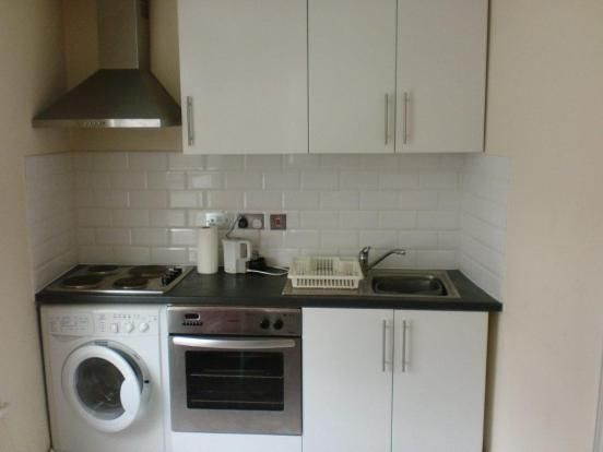 Tiny kitchen with washer. Would prefer the oven to be under the cooktop, but this is more what I want.