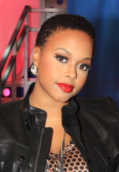 Chrisette Michele. Fake lashes and bright lipstick