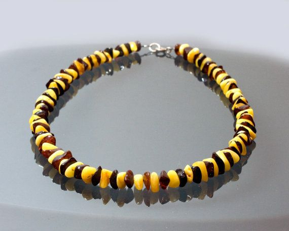 This is a 46 cm (17.5 inch) handmade butterscotch and cherry amber necklace on extra strong jewellery wire with a sterling silver closure.