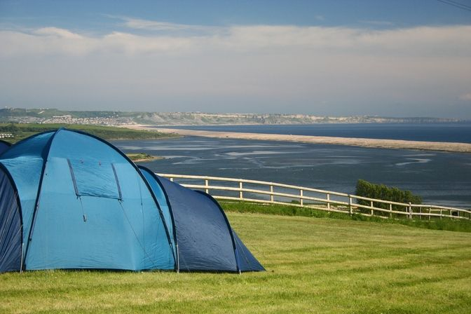 Arguably Dorset's most beautiful licensed Camping Park, Sea Barn Farm is a great base for your Dorset holiday.  We welcome tents and motor-homes with tents or awnings.  This park has breathtaking views of the Fleet