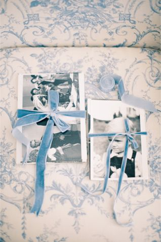 Velvet ribbon wrapped photographs | Anastasiya Belik Photography | http://burnettsboards.com/2013/12/powder-blue-white-wedding/
