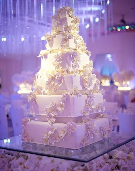 Elegant White Wedding Cake Clear plexiglass stand with flowers - Gorgeous, statement cake