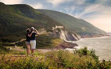 Photo of couple looking at scenery of the Cabot Trail Cape Breton