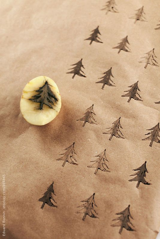 Christmas tree stamp on wrap gift. by BONNINSTUDIO - Stocksy United - Royalty-Free Stock Photos