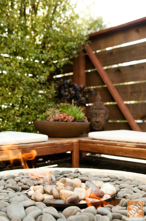 Small patio decorating ideas a fire pit adds warmth to a for Small balcony seating ideas
