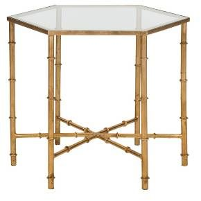 The updated Asian elegance of the Grendada Accent Tables faux bamboo blends classic Chinoiserie style and exotic detail. With gold leaf finish on its forged iron base and a clear glass top, Grendada brings sophisticated, eclectic flair to any décor.