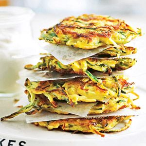 Bumper-Crop Zucchini Pancakes  These golden appetizers or dinnertime treats, flavored with Parmesan cheese and onion, will reign as a favorite pancake recipe. The secret ingredient is zucchini.