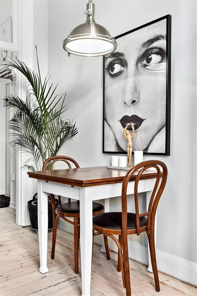 tiny dining room with great art