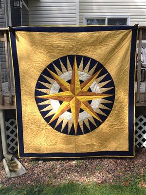 Simple and pretty.  Mariner's Compass - Quilters Club of America