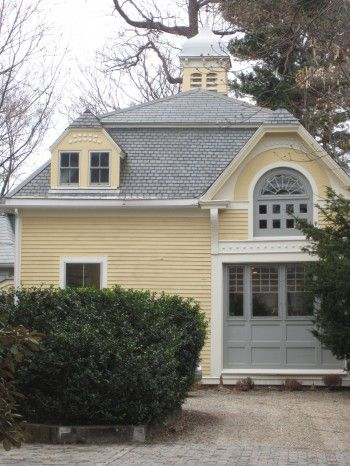 Yellow and gray carriage house. I like this for exterior colors.