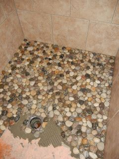 Something From Nothing: Pebble Shower Floor- my Mormor had the perfect collection of smooth stones for this:)