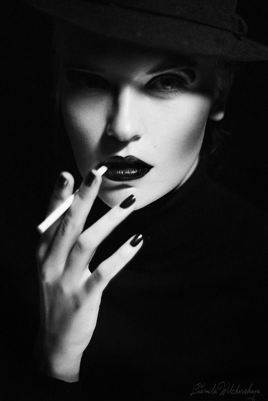 This image gives of an old fashioned noir feeling the way her makeup is applied and the cigarette the low key lighting really helps define her face