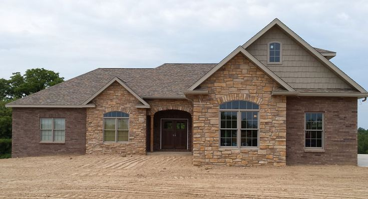 Classic brick ranch house plan with full basement the for Stone and brick home designs