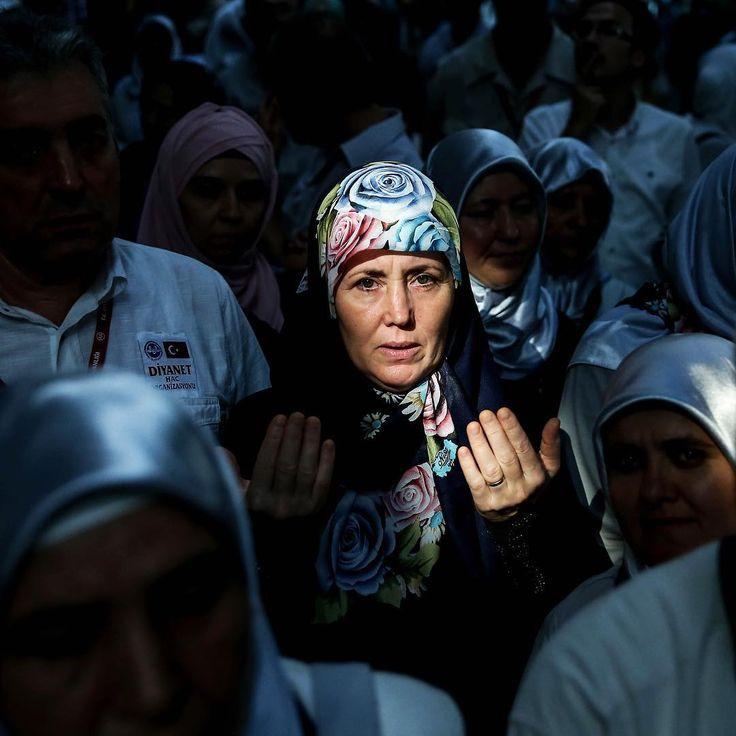 Turkish prospective Hajj pilgrims pray ahead of their departure to Saudi Arabia, to perform the pilgrimage, at Ataturk International Airport in Istanbul on Aug. 3. Photograph by Berk Ozkan (@berkozkan_)—Anadolu Agency/@gettyimages