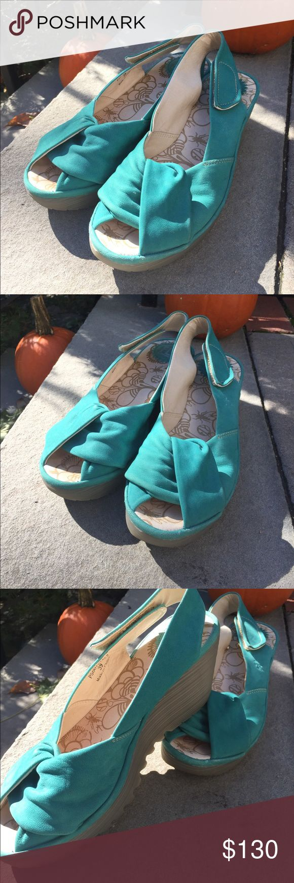 Fly London Turquoise Sandals Size 9. Euro 39. Worn on a few times. Suede sandals with a rubber platform. Fly London. Size 9. Euro 39. Fly London Shoes Sandals